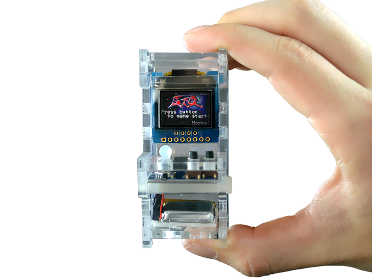 Tiny Arcade DIY Kit in someone's hand