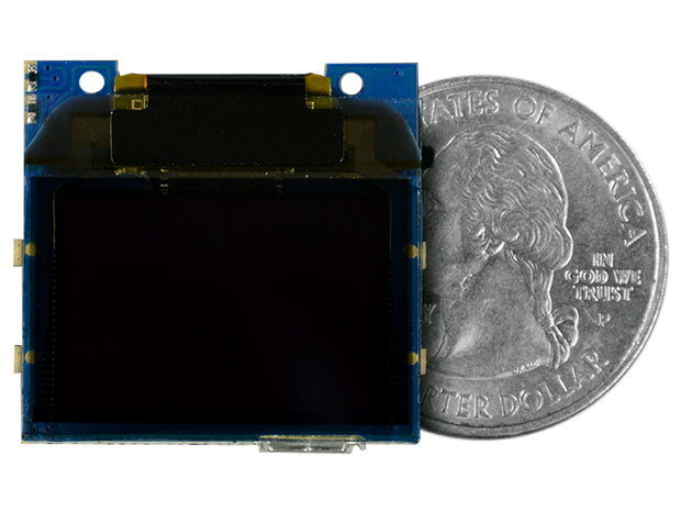 TinyScreen+ (Processor, OLED & USB in one) quarter size comparison
