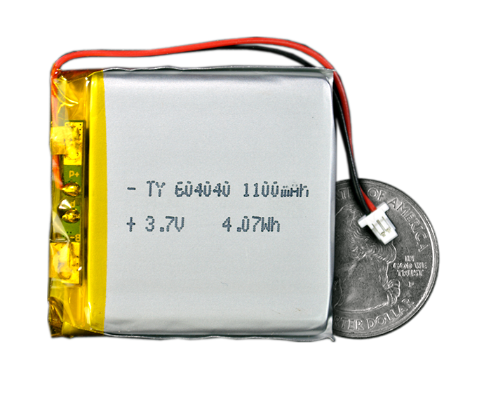 Lithium Ion Polymer Battery - 3.7V 1100mAh quarter size comparison