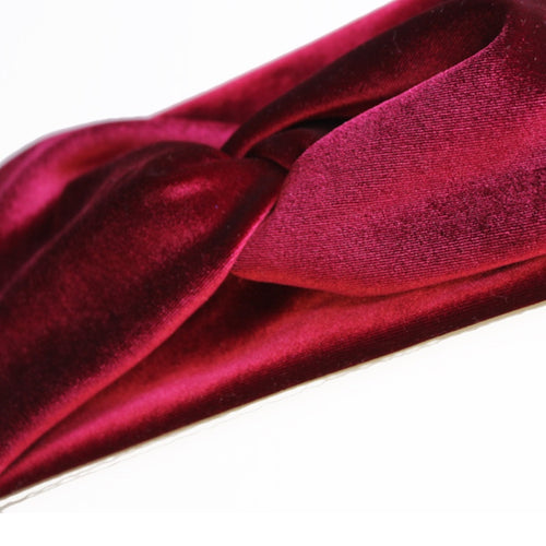 close up view of berry colored turban twist headband