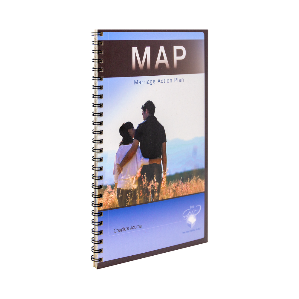 The catholic couples journal, the Marriage Action Plan (MAP) by Tom McCabe and Gregory Popcak, that accompanies the Joy Filled Marriage Study Program. The cover features a man with his arm around a woman in a field looking out at the mountains underneath a sunny blue sky.