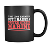 I May Look Harmless But I Raised A US Marine 11 oz Black Coffee Mug