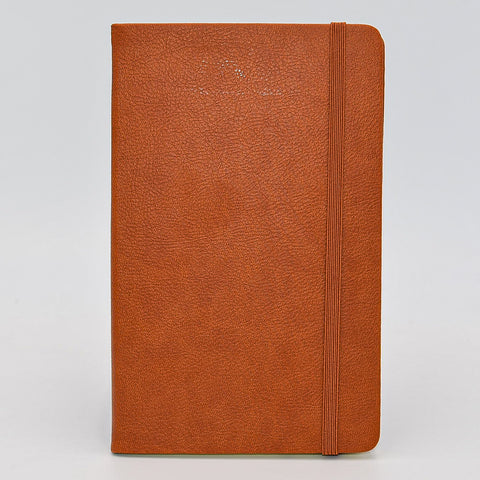 "Journal: Faux Leather Lined Case Bound Book with Elastic Closure  This vegan leather ruled journal is perfect for your travels, home, car, or office. With a convenient elastic band closure, keep your book closed with ease. With ivory ruled pages, keep easy notes throughout your day.  Available in Tan, White, and Blue  Dimensions: 5"" x 8"" tan british tan brown light brown"