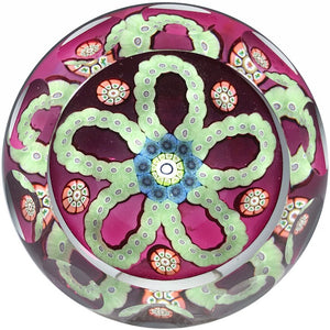 "Faceted Perthshire 1983 ""O"" Glass Paperweight Patterned Complex Millefiori Garlands on Transparent Ruby Ground"