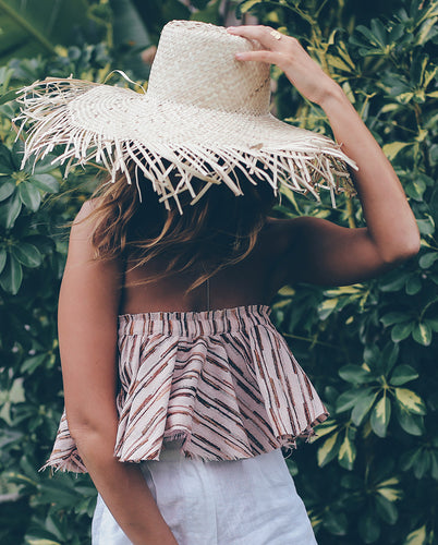 The San Sebastian Sundowner in Straw is a hand-woven, oversized straw hat with fringing - providing maximum protection and style.