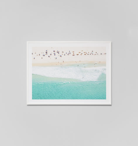 Rio - White is a framed, photographic print. This modern art piece features an aerial view of the ocean filled with people loving water sports and Summer. Produced in Australia by Middle Of Nowhere.