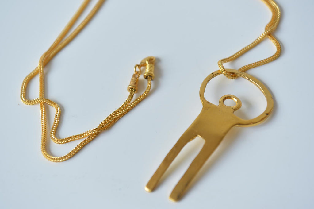 Gilded man pendant by Elisabeth Riveiro - L'Atelier Natalia Willmott