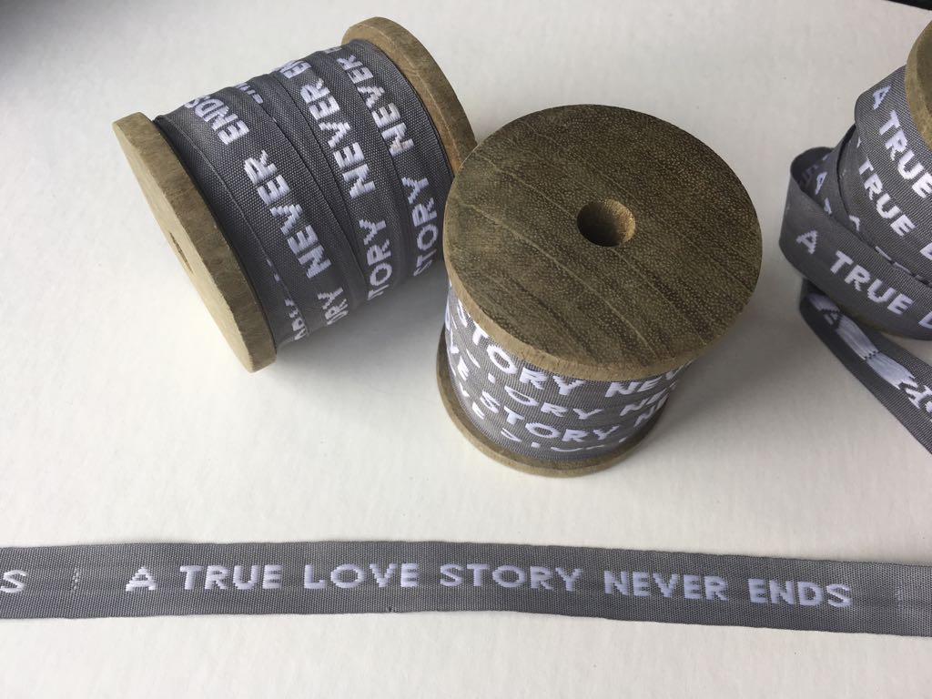 """A true love story never ends"" ribbon"
