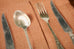 Pair of napkins and Pair of place mats printed with image of antique spoon, fork and knife - L'Atelier Natalia Willmott