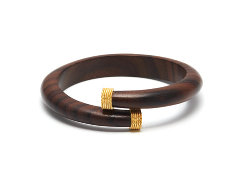 Dark wood spiral bangle with goldplated silver caps - L'Atelier Natalia Willmott