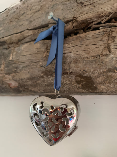 Silver heart metal pomander with light blue satin ribbon
