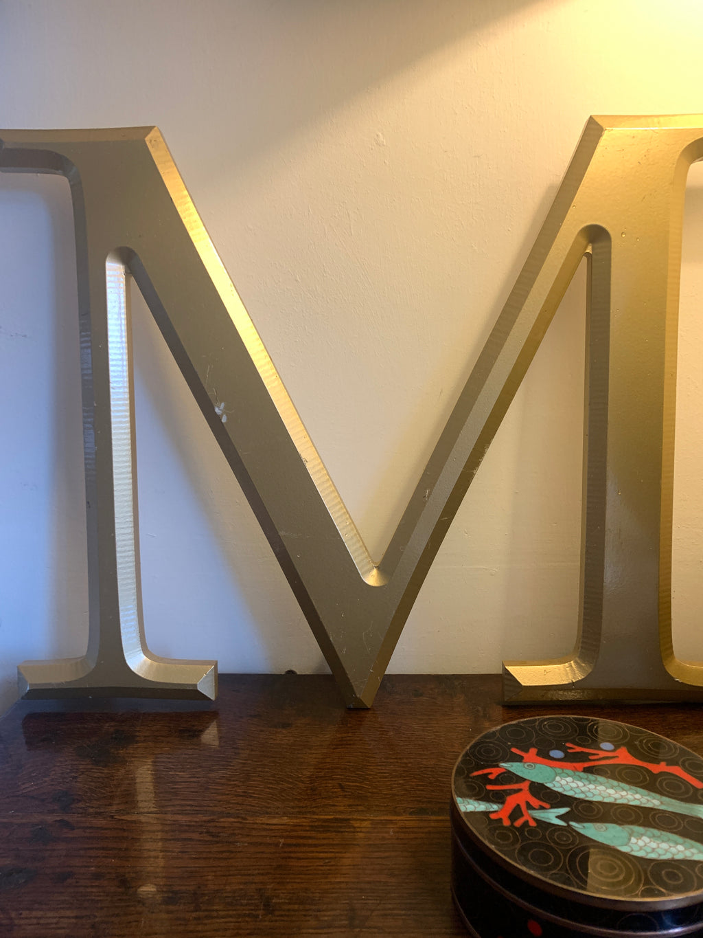 Large gold distressed letter