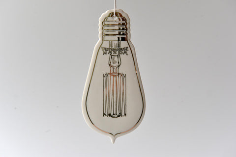 Hanging ceramic light bulb decoration - L'Atelier Natalia Willmott