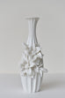"White porcelain vase with ""carved flowers"""