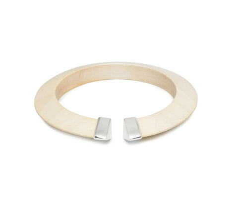 Shaped white wood bangle with sterling silver capped ends