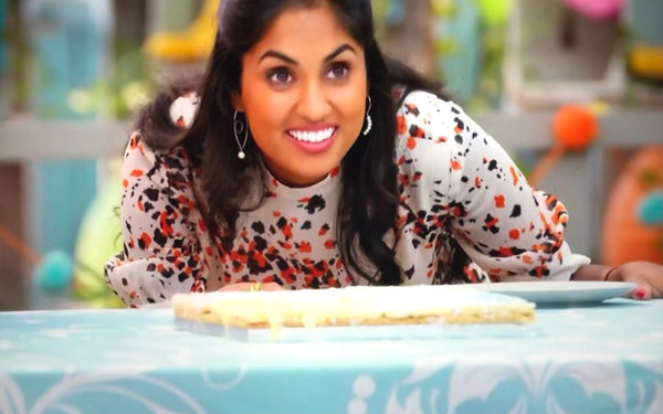 ravneet gill wears our glance and whisper pearl earrings from The Bias Cut on Junior Bake Off