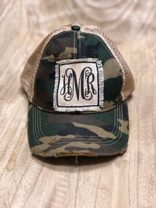 Distressed hat with black monogram