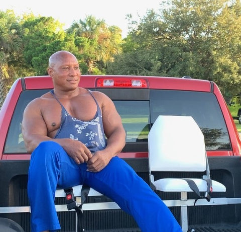 Mr.Loyd seated on white bucket style truck bed seats