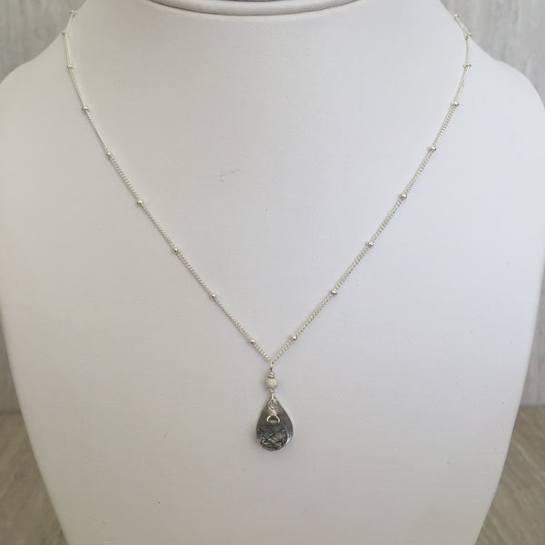 Black Rutilated Quartz on a brushed Silver Saucer Necklace N-16