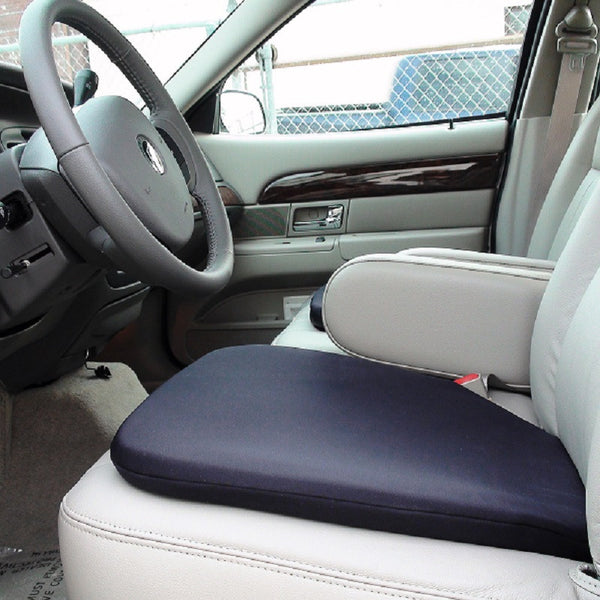 A comfortable gel seat cushion on top of the front seat in a car