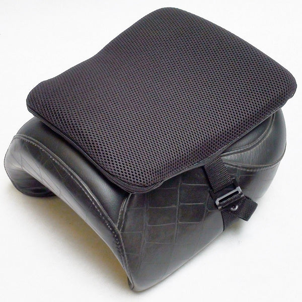 Motorcycle seat with a gel cushion on top of it