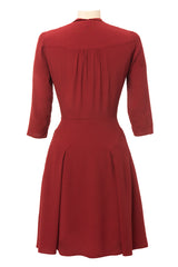 1940s inspired dress made of brick red fabric, 3/4 sleeves. Back view.