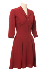 1940s inspired dress made of brick red fabric, 3/4 sleeves. Side view.