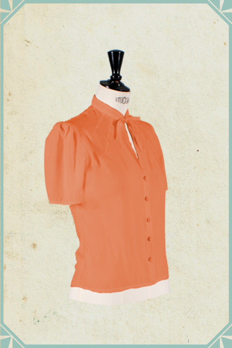 Versatility, comfort and design make Berlín collection a 1940's style orange blouse a wardrobe essential. Also available on black and white.