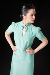 Berlín Collection features 1940's vintage style garments. This dress in green mint coloured fabric, has Art Deco details and classic 40's shape.