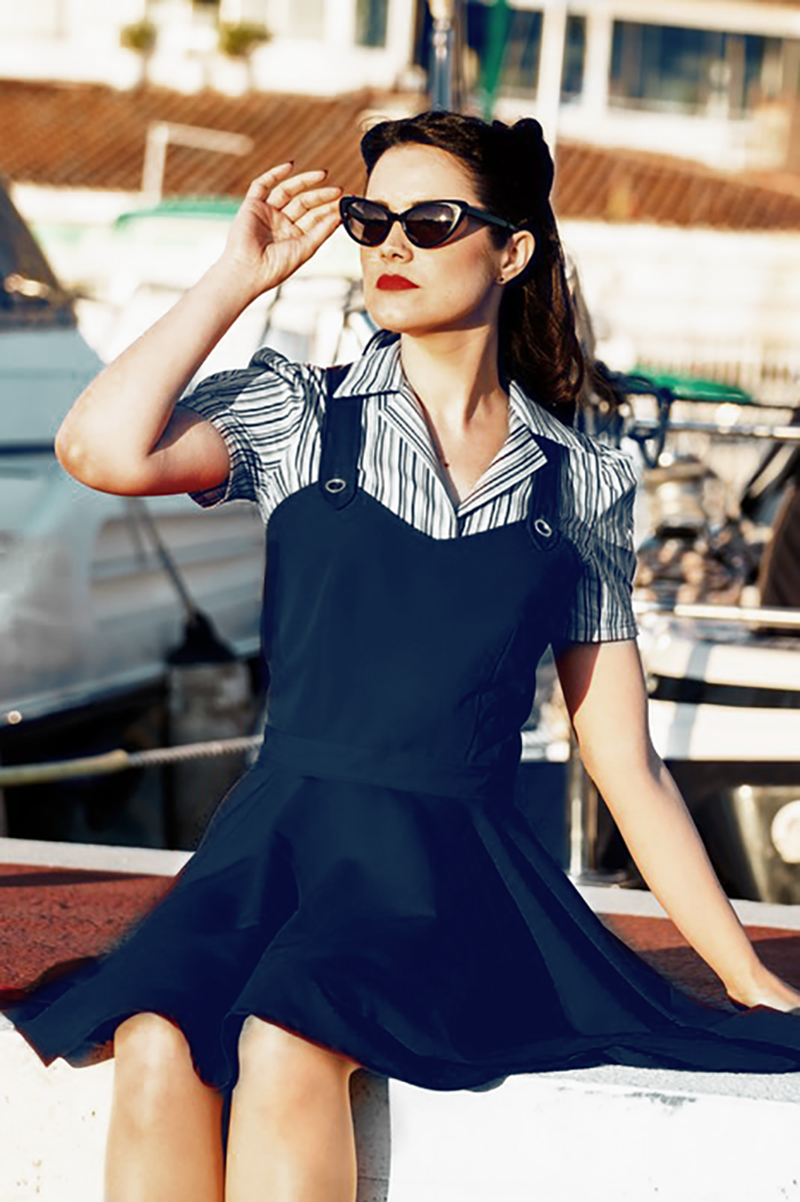 Such a cute and bold dungaree blue dress! With high-cut top darted snugly so you can wear it without a shirt too, and beautiful straps crossed at the back.