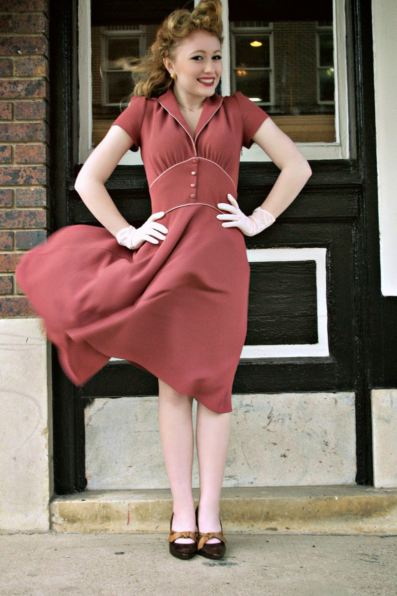 Ginger is a 1950's vintage style dress made of pale burgundy fabric that helps the skirt to flow soft and fluently. It also include vintage early days details.