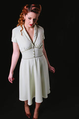 Ginger is a 1950's vintage style dress made of pale green fabric that helps the skirt to flow soft and fluently. It also include vintage early days details.