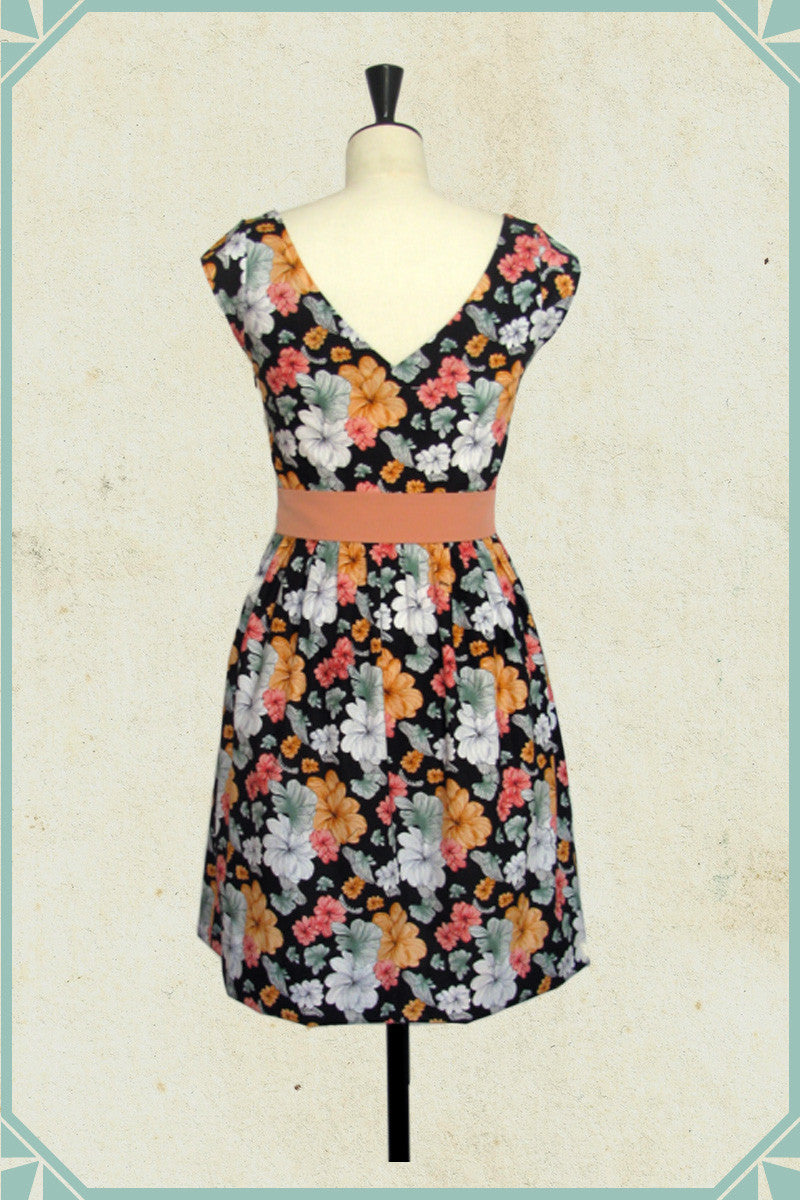 Grace is the perfect 1950's style black summertime dress made of a cotton printed fabric imported from Hawaii.
