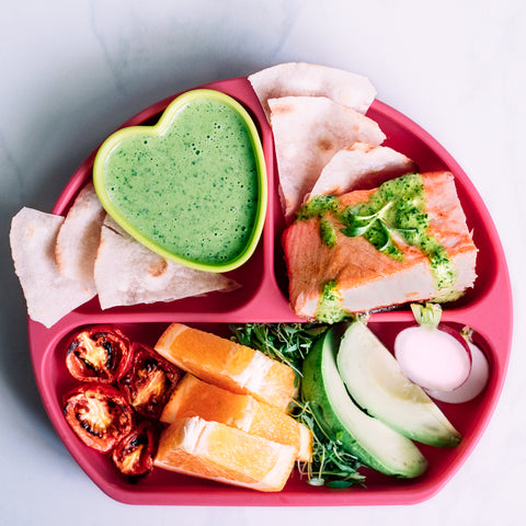 parsley dipping sauce in heart dish with salmon in divided toddler plate