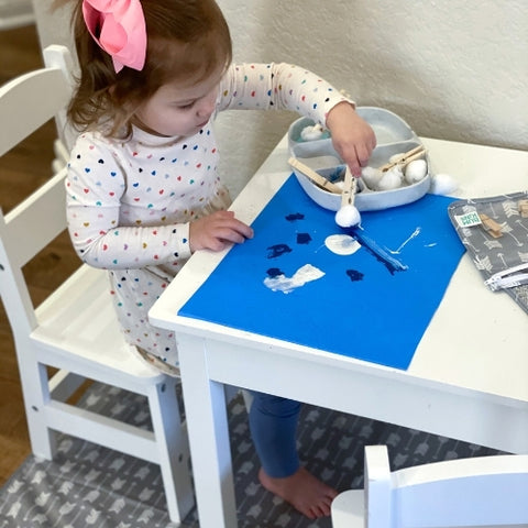 toddler doing easy craft activity