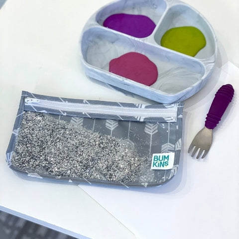 paint in a toddler paint, glitter in a reusable bag for crafts