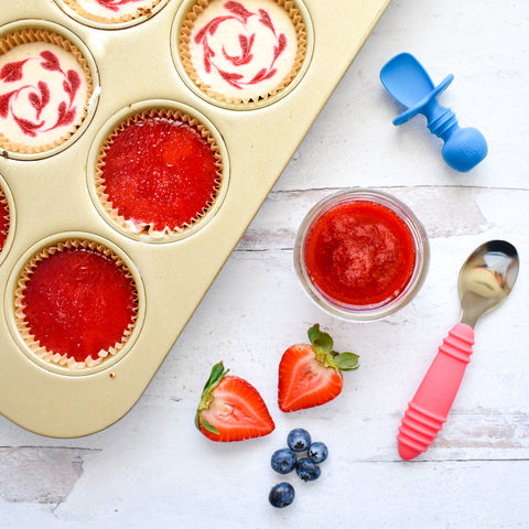 banana cheesecake in cupcake can with strawberry sauce
