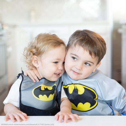 toddlers in matching batman bibs