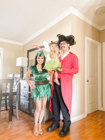 mom and dad dressed up with baby as Peter Pan characters