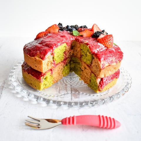 checkered spinach cake with fruit topping