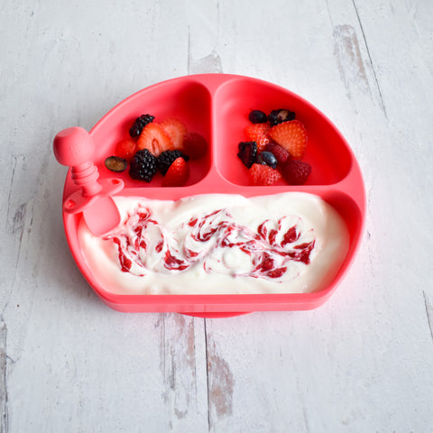 yogurt and raspberry jam in a toddler divided plate