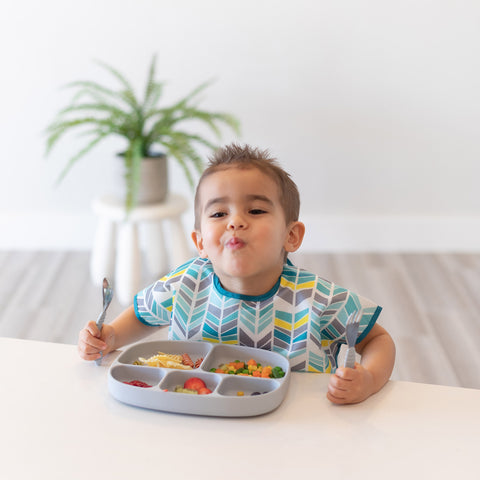 boy eating from 5-section divided children's plate