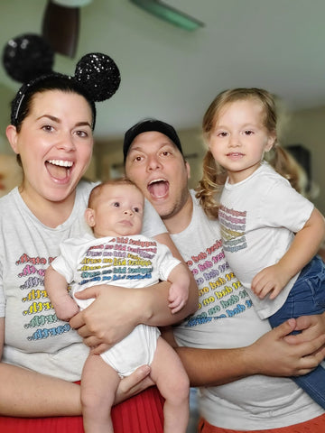 family in matching shirts laughing