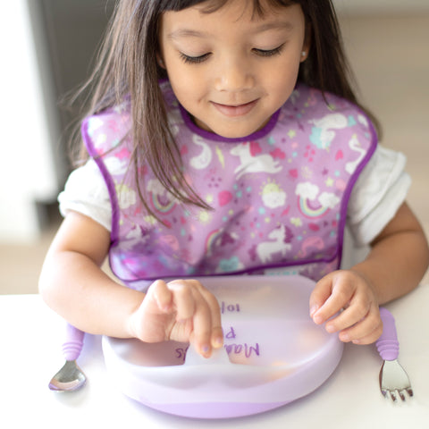 girl opening lid of lavender toddler plate