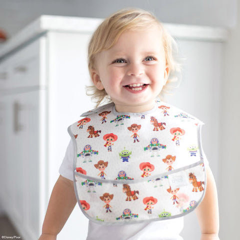 toddler smiling in toy story friends bib