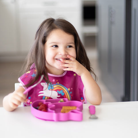 toddler eating out of unicorn plate
