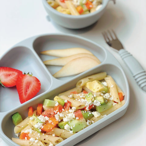 summer pasta salad in a toddler plate