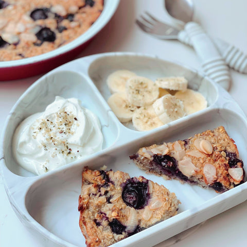 blueberry breakfast cake with bananas in a toddler plate