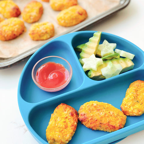 veggie tater tots in a blue toddler plate
