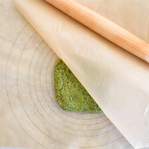 rolling out dough for spinach cookies